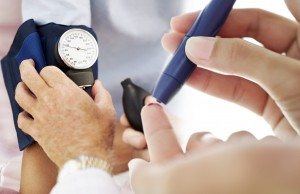 Pair of Human Hands Checking the Blood Pressure of a Patient