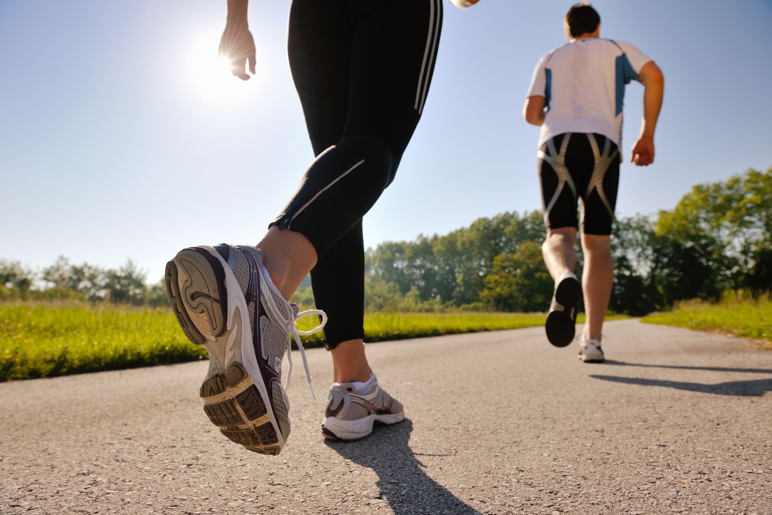 Young-couple-jogging-in-park-at-morning.-Health-and-fitness.-