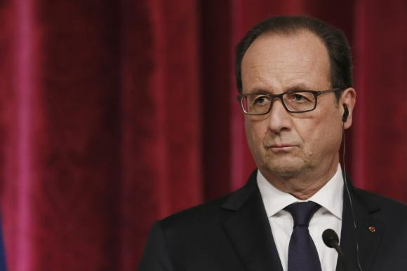 France's President Hollande attends a joint news conference at the Elysee Palace in Paris