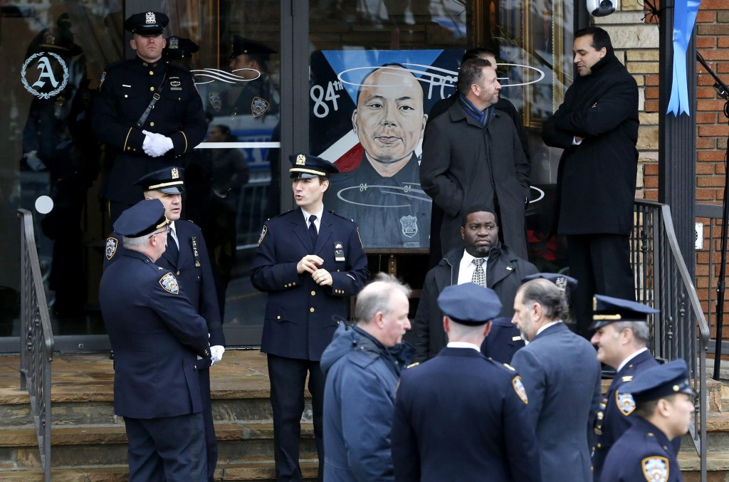 10, ooo people attended the funeral of slain officer Wenjian Liu