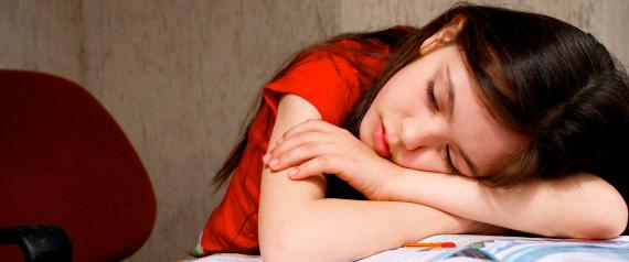 """poor child sleeping on book"""