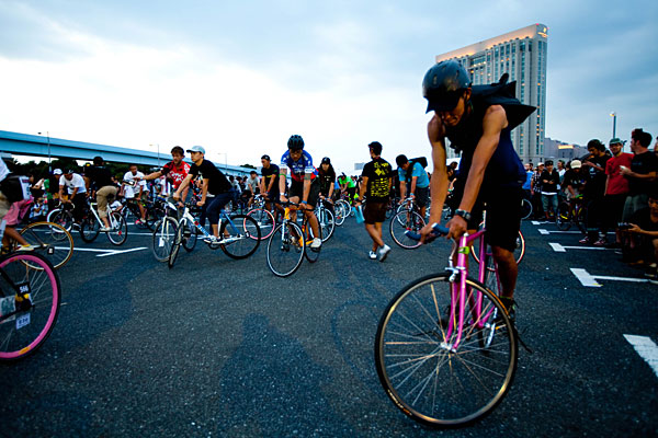 """alt=""""Cyclists Performing Track Stands"""""""