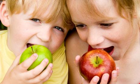 """Kids eating apples"""