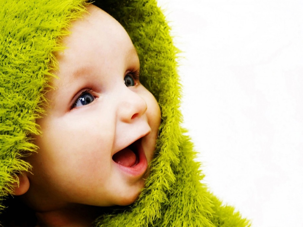 """""""smiling baby with green blanket"""""""
