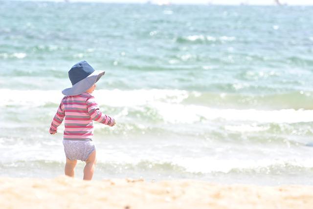"""child at the beach"""