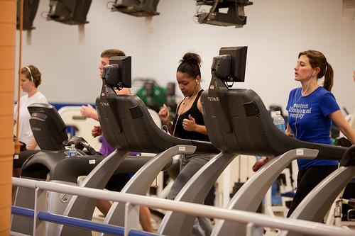 "alt=""Runners on Treadmills in Gym"""