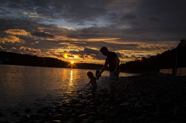 """""""Father and child by a lake at dusk."""""""