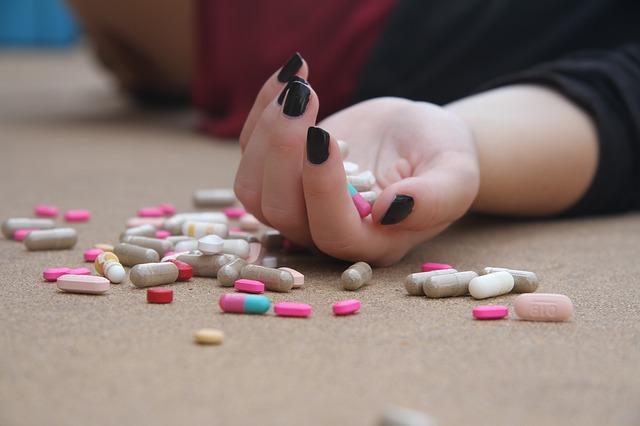 """""""Pills spilled on the floor next to an inert girl."""""""