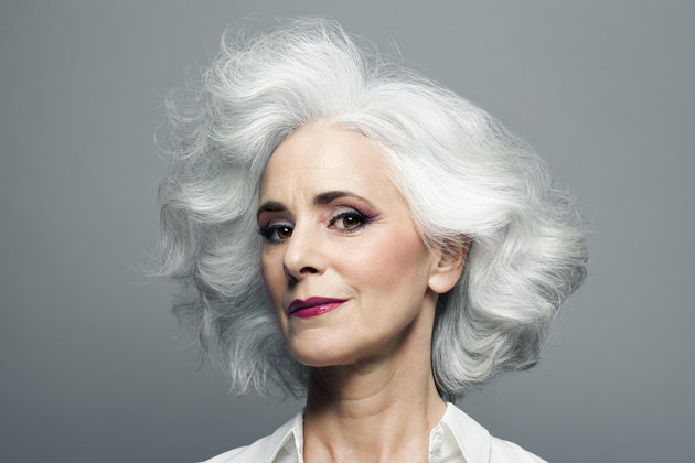 Grey haired woman with red lip stick, portrait.