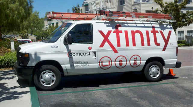 Comcast van bearing Xfinity logo