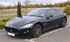 a black Maserati Gran Turismo