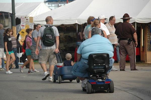 obese man on a scooter