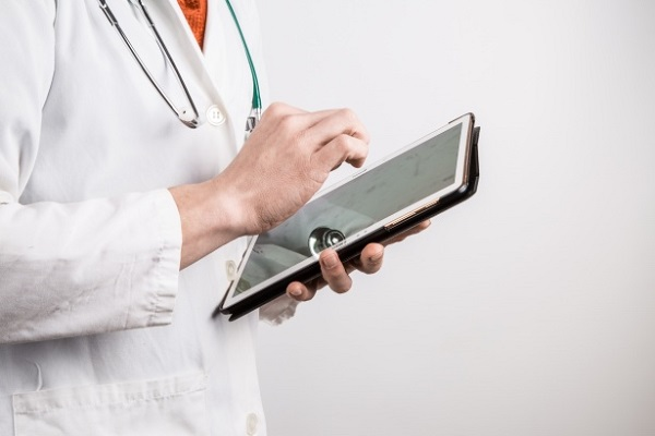 doctor with a tablet in hand