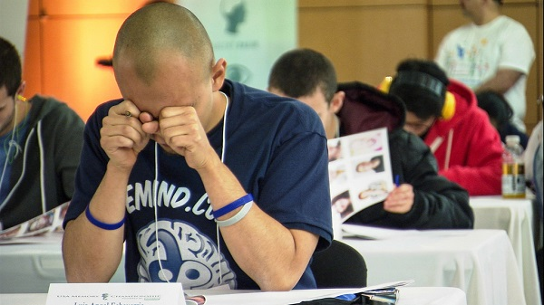 man during exam trying to remember