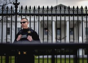 Secret Service agent standing guard outside the White House