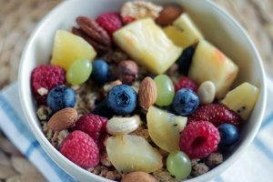 Bowl of oatmeal, fresh fruit and nuts