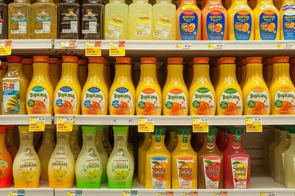 Orange juice bottles on Whole Foods shelves