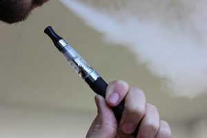 Electronic cigarette in man's hand