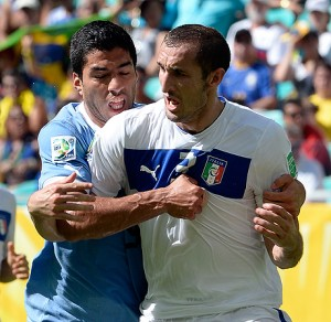 Italian soccer player Chiellini gets bitten by Uruguay forward Luis Suarez