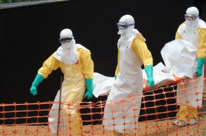 Medical personnel removes corpse of ebola outbreak victim