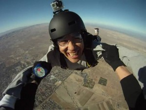 A shot of a skydiver with a GoPro camera mounted on his helmet.