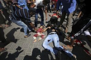 Mourning in Gaza: 10 Killed by Airstrike Near U.N. School in Rafah
