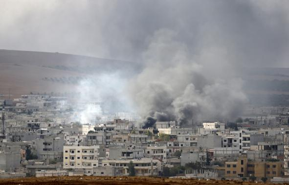 Smoke rises from the Syrian town of Kobani, seen from near the Mursitpinar border crossing on the Turkish-Syrian border in the southeastern town of Suruc