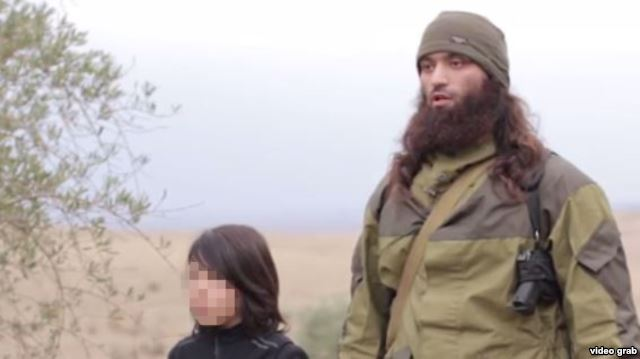 The Islamic State Films 10-Year-Old Executing Two Russian 'Spies'