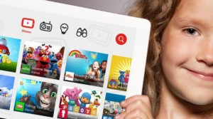 "alt=""child showing youtube kids app"""