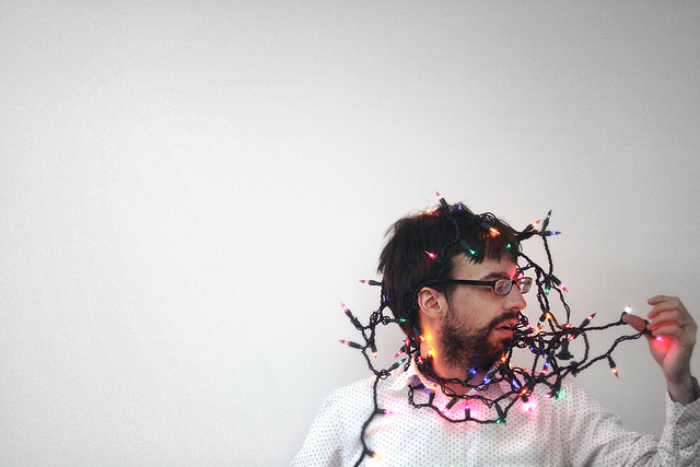"alt=""Man Wrapped in Christmas Lights"""