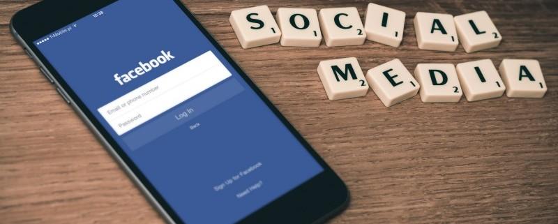 "alt=""Facebook App on Smartphone"""
