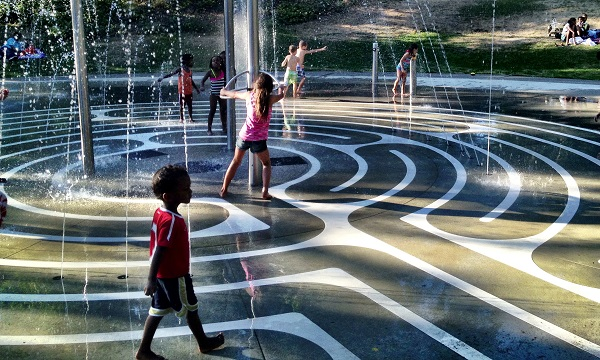 children playing in public fountain
