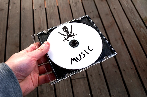 Person holding CD containing pirated music