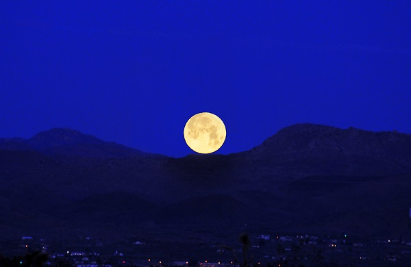 View of a huge moon at the horizon