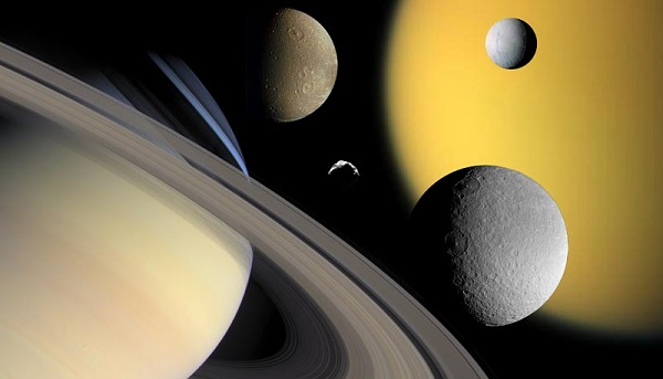 Saturn and four of its moons against the Sun