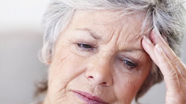 Old woman experiencing a migraine