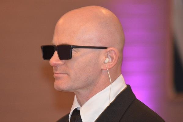 Bald man wearing sunglasses