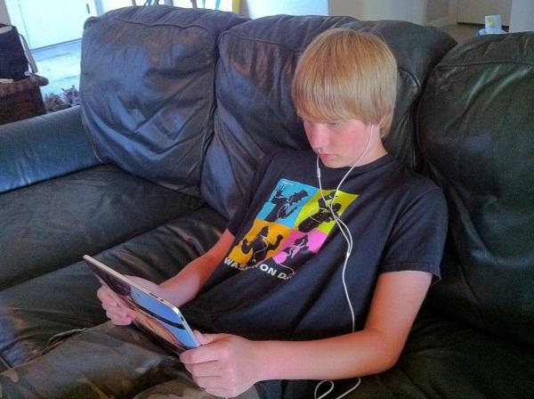 Teen Binge-watching Netflix on iPad