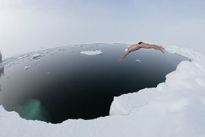 Swimmer Plunging into ice-cold water