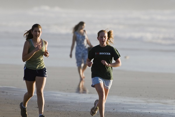 Girls jogging on the beach